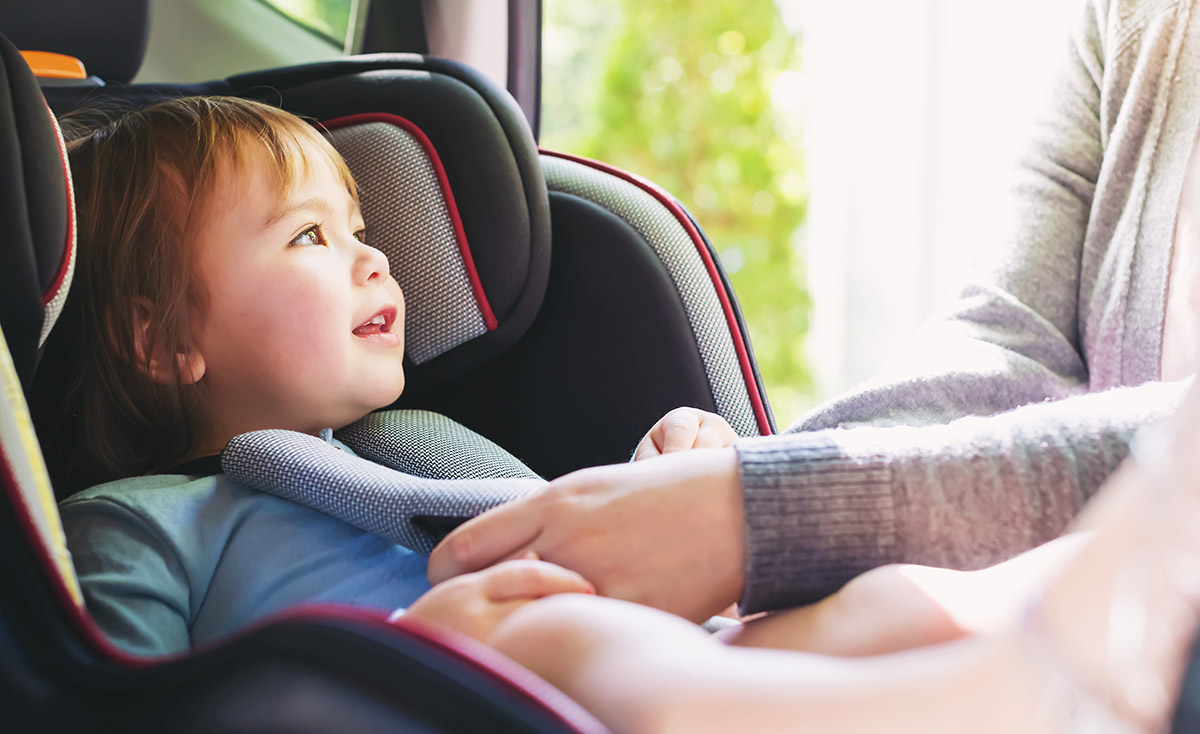 Parent buckles child car seat